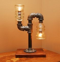 Industrial Style Pipe Lamp with Clear Glass Insulators and Wooden Base. $110.00, via Etsy.