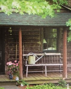 Rustic Cabin...woods...worn bench with old watering can...