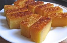 Traditional cassava (tapioca) cake is soft, chewy and fragrant. It has an inviting aroma from the screw pine leaves (pandan leaves), eggs and coconut milk. Just perfect for tea-time snack or as dessert. eggs, lightly beaten, 220 g sugar¼ tsp . Malaysian Dessert, Malaysian Food, Malaysian Recipes, Malaysian Cuisine, Filipino Desserts, Asian Desserts, Chinese Desserts, Filipino Food, Casava Cake Recipe