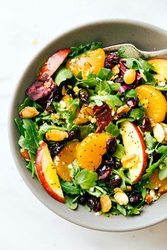 Mixed greens, mandarin orange, apples, cranberries, feta cheese, and easy stovetop candied almonds all covered in a delicious orange poppyseed dressing. via chelseasmessyapron.com