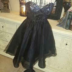 NEW  Blue Prom Gorgeous spring or summer time evening dress.  28 inches long under the bust where the flower is 26 inches, bust is 32 inches.  Zips up the back. May Queen Dresses Strapless