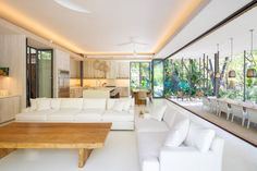 The interior features a neutral colour palette and materials such as teak, stone and Venetian plaster.
