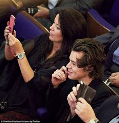 What's so funny? Harry smirks as he watches his sister collect her scroll as their mother Anne Twist takes photos