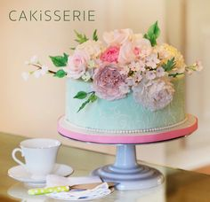 Happy Mother's Day! This one tier cake is decorated with a bouquet of sugar flowers - pink roses, David Austin roses, peonies, hydrangeas and cherry blossoms. www.cakisserie.com/bl…/mothers-day-cake-sugar-flower-bouquet
