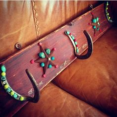 Horse shoe coat rack...  Like the little bit of sparkle and color!