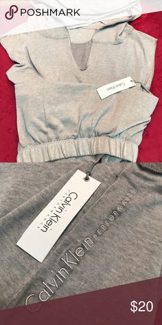 Calvin Klein Hoodie Gathered elastic band in front- at waist, drapes lower in back. Calvin Klein Tops Sweatshirts & Hoodies