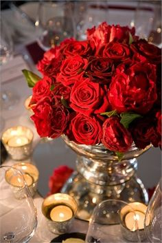 Sumptuous Red peonies and roses on crisp white linen with silver elements! Gorgeous