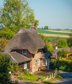 A pretty thatched cottage above the village of Pitton in Wiltshire, England. Storybook Homes, Storybook Cottage, English Country Cottages, English Countryside, English Village, Little Cottages, Cabins And Cottages, Cottage Homes, Cottage Style