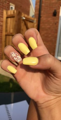 Yellow acrylic nails with flowers Accent nail, clear acrylic, yellow, summer, soft girl aesthetic Acrylic Nails Glitter Ombre, Acrylic Nails Almond Short, Acrylic Nails Yellow, Rounded Acrylic Nails, Clear Acrylic Nails, Summer Acrylic Nails, Yellow Nail Art, Accent Nail Designs, Cute Acrylic Nail Designs
