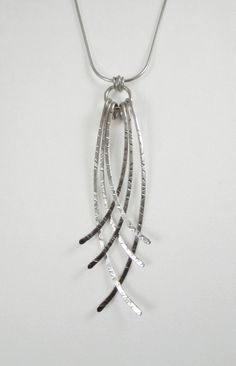 Hammered wire pendant.