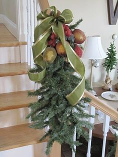 Artifical Christmas tree branch hung on the stair bannister
