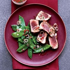 Spice-Crusted Tuna with Thai Snow Pea Salad | Hearty-healthy tuna is a high-protein source of omega-3 fatty acids. Andrew Murray pairs it with a vibrant salad made with crisp snow peas, a good source of B vitamins and vitamin C.