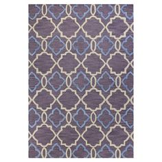 Adorned with a chic quatrefoil motif and highlighted by a lilac palette, this hand-tufted wool rug brings visual interest to your living room or den.