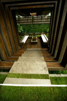 Garden designed for Chelsea Flower Show 2012 by David Cubero and James Wong with frame structure around the steps leading to the patio area - #modern #contemporary #landscape #garden #design