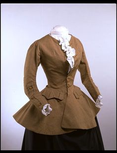 Women's riding outfits, known as 'riding habits', of the 18th century adapted elements of men's dress. This jacket of the 1750s is styled after a man's coat, although it has been modified with a waist seam to fit over stays and a wide petticoat. Another masculine element is the mariner's cuff, with a scalloped flap running parallel to the length of the sleeve. It was a style first seen on the coats of naval officers, although their uniform was not officially defined until 1748. The…