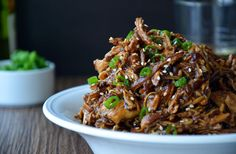 This slow cooker chicken honey garlic chicken recipe stars tender shredded chicken breasts tossed in a sweet and tangy Asian-inspired sauce.
