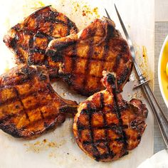 Ultimate Grilled Pork Chops Recipe from Taste of Home   A little brining and a special dry rub go a long way to making the perfect pork chop.