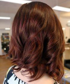 Medium deep Brown hair color. Shiny hair. Curly hair.