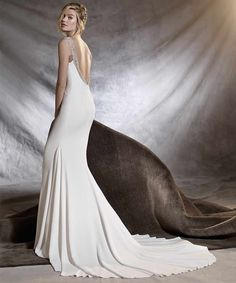 Wedding dresses with amazing backs are something which so many brides search for, and when you come across designs like Olalde by Pronovias, you know you have found something special. The soft and easy-flowing fabric that the dress is made from will be super flattering and skim over your skin and the plunge back and beaded detail is what really takes it up a notch.