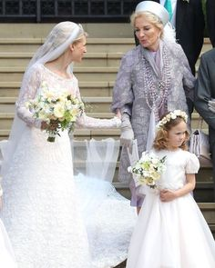 Newlywed Lady Gabriella Windsor with her mother Princess Michael of Kent and a young bridesmaid on the steps of the chapel after her wedding to Mr Thomas Kingston at St George's Chapel on May Get premium, high resolution news photos at Getty Images Royal Brides, Royal Weddings, Wedding Bride, Wedding Gowns, Wedding Ceremony, Wedding Outfits, Prince Michael Of Kent, Carole Middleton, Eugenie Of York