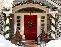 Ornament and Pine garlands decorating the front door entryway, and love the red front door!
