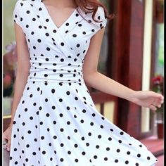 "White with Black Polkadot Dress. 100% Polyester it has lining on the skirt only. It has a zipper on left side of the torso. Polkadot Dress bust 34"" inches. Waistline 28"" inches and 37"".5 inches in length."