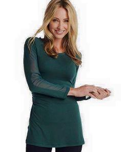 Ruby Ribbon Tunic in Hunter Green with a sheer strip down the arm.  Comfy!