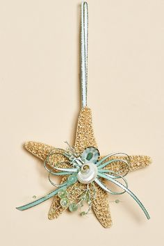 So pretty, coastal sugar starfish ornaments decorated with aqua ribbon and beads with pearlized shells. Think wedding decor instead of Christmas ornament ; Seashell Christmas Ornaments, Beach Ornaments, Nautical Christmas, Beach Christmas, Christmas Crafts, Christmas Decorations, Christmas Tree, Seashell Art, Seashell Crafts