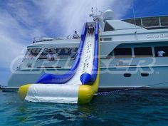 Carte Blanche with a FreeStyle Cruiser inflatable water slide. #Yachts #YachtToys #YachtWaterToys