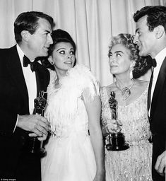 (Left to right) Gregory Peck, Sophia Loren, Joan Crawford and Maximilian Schell stand back...