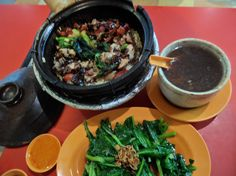Claypot chicken rice, with peanut and chicken feet soup and a simple vegetables with oyster sauce.