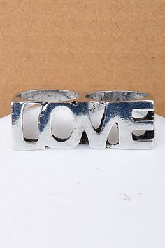 Double Finger LOVE ring! Available now at TheFashionHouse.biz !!