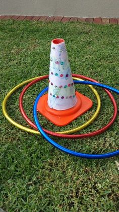 Toss the hoop on the unicorn horn party game. Rainbow and unicorn party