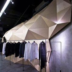 Lurdes Bergada Flagship Store by Deardesign clothing store wood geometric triangle