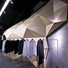 Lurdes Bergada Flagship Store by Deardesign  clothing store wood geometric triangle