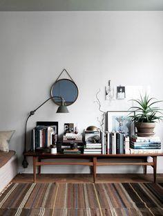 round mirrors.  Teak.  Plants.  Lots of books.