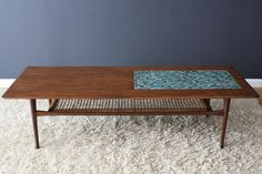 Danish Modern Coffee Table by Selig.  Cane shelf below and a mosaic tile inlay on top.  Photo credit: midcentury modern finds