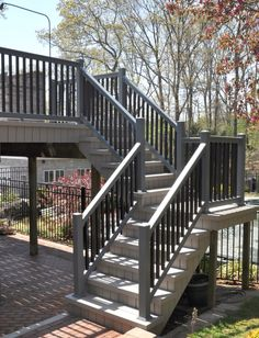 Illusions pvc vinyl gray and black deck Illusions pvc vinyl gray and black deck railing Wood Deck Railing, Deck Railing Design, Vinyl Railing, Deck Design, Railing Ideas, Deck Stairs, Porch Wood, Outdoor Stairs, Cable Railing