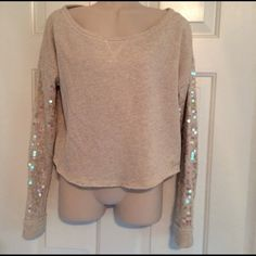 Aeropostale sparkly oatmeal cropped sweatshirt This cute and comfy cropped sweatshirt has mother of pearl colored paillettes on the sleeves - gently worn. The edges of the hems were distressed when purchased. In good condition, no holes or stains. Aeropostale Tops Sweatshirts & Hoodies