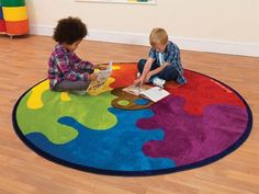 Large circular colourful nylon pile rug.  All our rugs are made to a high quality with heavy duty nylon pile for durability, yet provides a soft textured finish. In a range of vibrant designs that can be used interactively with young readers. All rugs have a non-slip backing and are stain resistant.