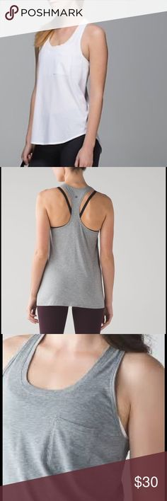 Lululemon yogi racerback BLACK Lululemon yogi racerback in BLACK, white and grey photos are company photos for reference. This racerback is cotton, has a front pocket, scallop hem, and high-low hem line. Comes from a per free and smoke free home. lululemon athletica Tops Tank Tops
