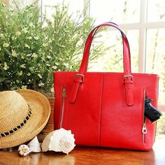 http://shop.concealedcarrie.com/all-products/smooth-red-leather-tote.html