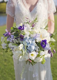 Spring bridal bouquet. Blues and Whites, Roses, Sweet Peas. Anemones, Clematis, Hydrangeas.