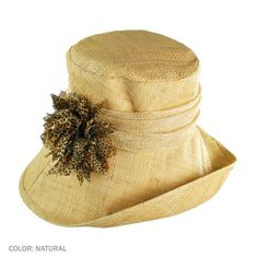 """Kathy Jeanne Off Face Brim Hat (Natural) We are proud to present the Kathy Jeanne line to our website. This gorgeous off face brim cloche is adorned with a chiffon animal print flower. What a great way to grab someone's attention.    4"""" Crown.  3 1/2""""  Off Face Brim.  4 1/2"""" Side Brim.    Made of:  Straw Cloth    Lined.  Hand Blocked.  Animal Print Flower..       One Size Fits up to a size Medium / 57cm / 7 1/8   $ 60"""