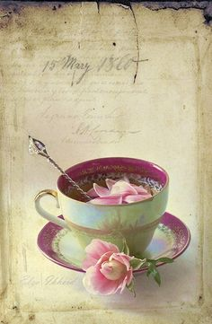 Pretty tea cup, saucer, and flower