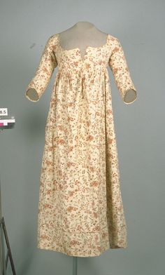 Date Made: 1800-1807  Description:  Dress; ivory cotton with floral block printed design, linen lining. Red, brown, and green floral print on an ivory ground.