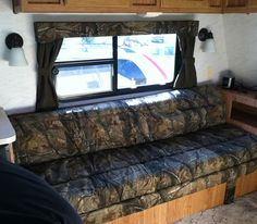 This is our travel trailer. We had the cushions recovered in camo -looks so cool!