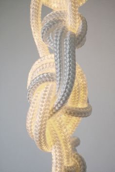 Back in the 70's I designed a huge boat rope sculpture that hung from my bedroom corner ceiling. I loved it.  Ropes by Christian Haas.
