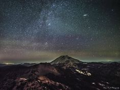Andromeda Galaxy and part of the disc of the Milky Way rising over Lassen Peak in Northern California.