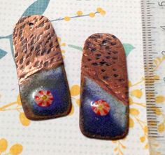 foldform hammered textured torch fired enamel copper charms with murrini detail
